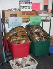 Dog and cat food in bins from Community Sharing