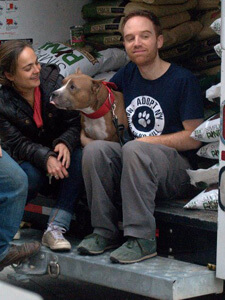 A rescue dog with employees from 2012 Disaster Relief Summary